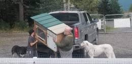 Rick and Joey unloading the 4th bunny house.